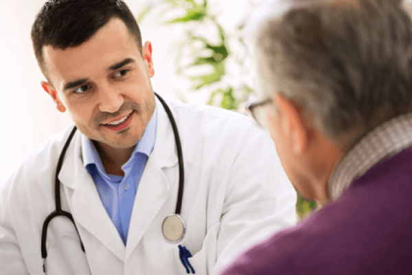 doctor speaking to a patient