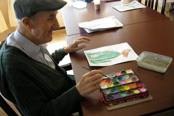 Assisted Living resident painting